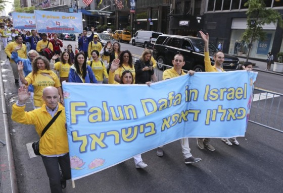 Nearly 10,000 Falun Gong practitioners take part in a grand parade through Manhattan to celebrate World Falun Dafa Day.